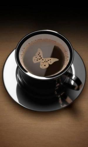 Пенка Бабочка в чашечке кофе